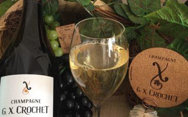 Sous-verre en situation avec bouteille et verre Champagne G. X. CROCHET- 3 mm-traité